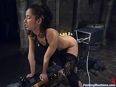 Sexy brunette Isis Love is having fun in a basement. She pets herself and then gets her snatch slammed by a fucking machine from behind.