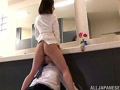Slim and pretty Asian woman lifts her skirt up. She gets her vagina licked by some gentleman and also makes his cum with hands.
