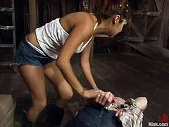 Naughty girl undresses and ties up Bridgett Harrington. After that she puts her panties in his mouth and drills his ass from behind.
