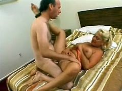 Salacious blonde mom Dana Hayes is having fun with two dudes indoors. She sucks and rubs their wangs devotedly and then gets her cunt and butt pounded hard.