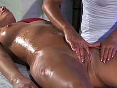 Dazzling brunette babe gets oiled up and massaged by nice blonde girl. After that the brunette chick gets her pink and wet pussy fingered in close-up scenes.