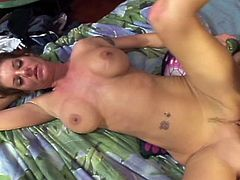 Enjoy this hot brunette milf with huge tits rubbing and fingering her cunt on the bed.Her young lover wakes up and she goes on him.Enjoy her sucking that big cock of his and getting her lusty pussy fucked by him till he shoots out his cum on her.