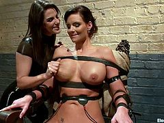 Curvaceous Phoenix Marie sits on a chair being tied up by Bobbi Starr. Later on she gets wired and toyed rough.