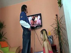 Pretty blonde teenie got caught watching porn. She must blow this guy's stiff cock to make it hard and to let him pound her tight shaved pussy like a savage.