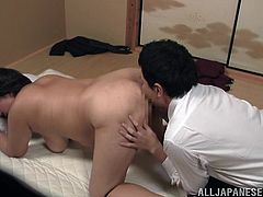 A lewd Japanese mom allows her man to rub her huge ass. Then she sucks and rubs his wang and gets fucked in missionary position and doggy style.