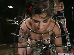 Submissive brunette chick gets her pussy lips fixed with claws. After that she also gets tied up and suspended. She also gets her pussy hit with electricity.