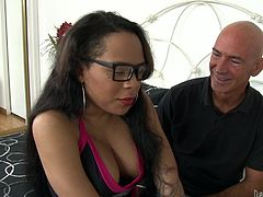 Shemale cheerleader Nody looks dorky, but she's hot and wants some action. The bald man that hired her thought that she could be used in other ways so in no time she found herself jerked by him. He plays with her hard penis and makes the slut moan. Watch those big boobs and her sweet dick!