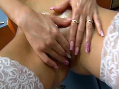 Watch this sexy brunette babe in white stocking pouring oil over her sexy body before she sits on the floor and masturbates her tight pussy by spreading her legs.
