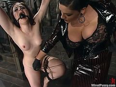 Betka Schpitz gets bound by Caroline Pierce in a basement. Carol attaches wires all over Betka's twat and boobs and they both enjoy it much.