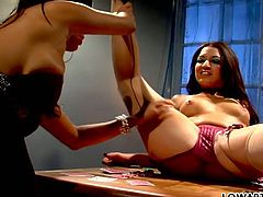 Two zealous brunette lesbians with gorgeous bodies get naked lying on the poker table and greedily lick each other's tight shaved pussies.