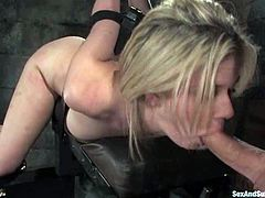 Brandon Iron binds beautiful blonde Fayth Deluca in a basement. Then he whips her butt, makes the girl suck his prick and drills her nice coochie afterwards.
