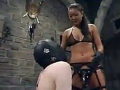 Asian chick in fishnets and black lingerie ties Jack up and spanks his ass. After that she fixes claws to his nipples and toys the ass with a strap-on.