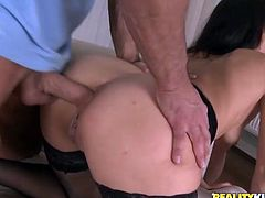 Take a look at this horny brunette in very sensual lingerie as she's nailed by two guys at the same time in a hardcore threesome.