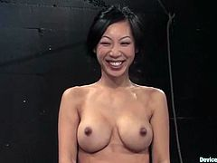 Beautiful Asian chick Tia Ling is having fun with a man in a basement. The dude ties the bitch up and hangs her up by the legs.