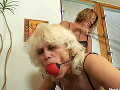 It's time for some mom action! Blonde mom whores Anastazie and Halina are up to no good. One of the whores plays the role of a submissive sex slave and she stays down on her knees, ball gagged and enjoys a rough ass spanking. She then licks pussy like she means it and loves it! What fucking filthy whores they are!