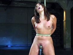 Horny brunette girl strips her clothes off and gets tied up by some dude. After that he pleases her vagina with a vibrator.