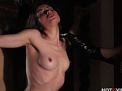 Watch these two hot babes in this HotGVibe video.This round ass blonde milf Ginger Hell binds sexy brunette babe Valeri Bianco to the wall for spanking and slapping her with the HotGVibe.This sexy milf fingers her with latex gloves and the power vibrator make her squirts hard.