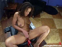 Ebony skank Jaime is playing with a fucking machine indoors. She pleases herself with fingering first and then gets her cunt smashed by the device.