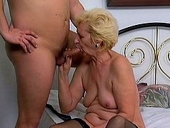 Insatiable blonde granny Beatrice wearing stockings is having fun with some guy in the bedroom. She gives him a passionate blowjob and then they fuck in cowgirl and missionary positions.