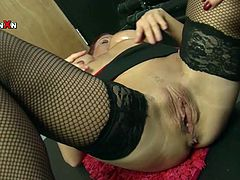 Filthy fisting action featuring raunchy redhead slut. She is wearing tight red corset and fishnet stockings. First, she gets her cunt drilled with huge sex toy. Later on she is fisted bad.