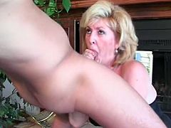 Sexy blonde mom Kitty Foxx pleases some guy with a stunning blowjob. Then they fuck in cowgirl position on the floor and seem to be unable to stop.
