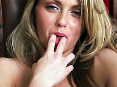Staci Silverstone with tiny boobs and smooth muff has fire in her eyes as she dildo fucks her bush