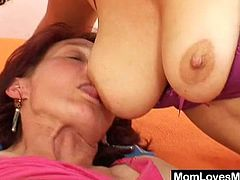 This bosomy lesbian milf sits on a horny grandma's face. Then, they both take a toy and shove it deep in their pussies. They masturbate next to each other.