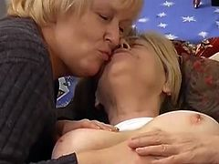 Here we have two old time worn bitches giving lesbian performance. Blonde grandma lies on couch with her legs wide open while the other granny fucks her dirty hairy muff with big red dildo.