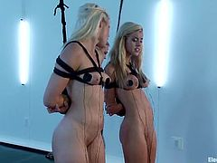 Two amazing blonde girls get tied up by their brunette mistress. Later on these blondes get their tits wired and pussies drilled with electric dildos.