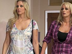 Check out two gorgeous blonde housewives getting wild at home. Lesbo MILFs diligently lick each other's delicious shaved pussies and then finger fuck each other.