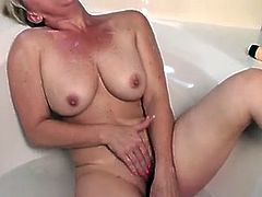 Bobbie Jones is the sultry blonde with curves for days! Her luscious tits and large nipples will leave you salivating for more.Watch her taking hot bubble bath while masturbating her lusty pussy in the tub.