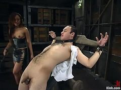 Petite Asian hottie Annie Cruz is having fun with some stud called Sir C. She binds and suspends the man and then attaches leads to his dick and beats the dude.