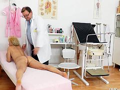 Granny whore Patricie is at her local doc for a check up. She lays naked on the table and the doc inserts a thermometer in her anus to check her temperature. It seems that she's a bit to hot so he asks her to sit on the gynecologist table to have a look at her pussy. Yeah, look at that snatch!