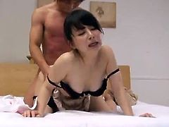 Asian babe having fun with her boyfriends dick