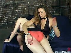 Insatiable dominatrix Kym Wilde is going to teach blonde hottie Veronika a good lesson. Kym humiliates the cutie and then fucks her pussy and mouth with a massive vibrator.