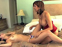 This teen babe is surprised when Miss Daniels makes a move on her. The busty milf plays with her nipples to turn her on and then she licks her really young twat.