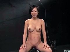 Sexy Asian chick Tia Ling lets some guy bind her and hang her head over heels in a vault. Then the man plays with Tia's tits and pussy and it makes the slut get a strong orgasm.
