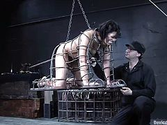 Sexy brunette Satine Phoenix allows some dude to put her into a cage in a basement. Then she takes a dildo in her cunt and gets it amazingly drilled.