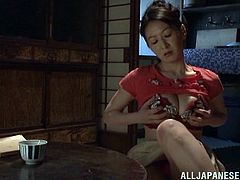Lustful Japanese MILF has flashbacks of her amazing sex. So, she fondles her boobs and pussy. Then she takes big pink dildo and makes herself cum.
