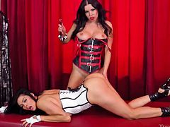 Tera was a very bad girl and now Pierce has to punish her! The brunettes love their games and Tera wears her white corset and obeys her evil gf. She gets her pussy and ass spanked for a while, just to get the point. Looks like the whores are taking their time in this. Maybe things will get a bit more rough!
