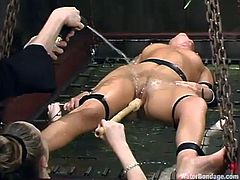 This juicy and busty chick is a sex slave and she is going to be tortured by one of the most cruel mistresses of the BDSM world. Water bondage is the subject of the night!