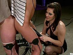 A redhead and a blonde chicks get tied up by their brunette mistress. Then these submissive babes get stimulated with electricity and toyed.