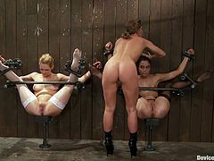 Two adorable girls in stockings get tied up to a wall. Then their mistress come up and whips these chicks. Later on they get fisted and toyed.