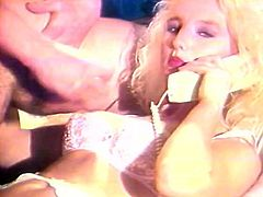 The Classic Porn studios has a great retro threesome scene for you! Busty blond hooker Trinity Loren gives blowjob and then gets her huge tits fucked and sprayed with sticky goo.