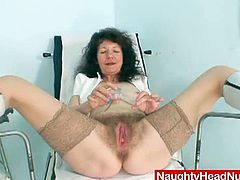 Karla is a bored mommy. At work she is often left alone. This time she takes a speculum and examines her own hairy twat instead of waiting for the doctor to do that.