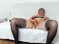 Blonde mature Berta has something hot for us! She takes off her sexy lingerie, makes herself comfortable on that couch and then spreads her thighs. Berta has a tight pussy between her legs and gladly spreads it for us. Damn, look at it, although she has an age, her pussy looks firm and ready for cock!