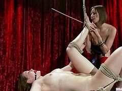Maitresse Madeline and Sofia Lauryn are getting naughty indoors. Maitresse binds Sofia and whips her and then plays with her meaty pink vag and pounds it with a strapon.