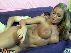 Busty blonde gives a titjob and rides a dick on a sofa