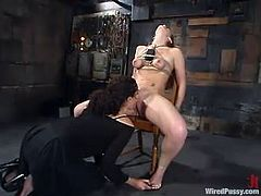 Jade Marxxx is having BDSM fun with some girl in a basement. She lets the dominatrix tie her up and then gets fucked by a sex machine and gets a great orgasm.
