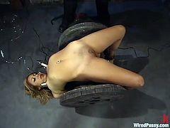 Pretty girl gets dominated by nasty mistress. She gets tied up and toyed with a vibrator. Later on she gets her tits shocked with electricity.
